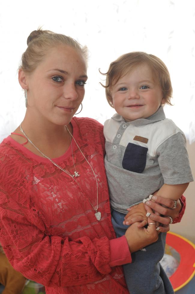 Safe – baby Ryan with his mum, Katie, after their ordeal