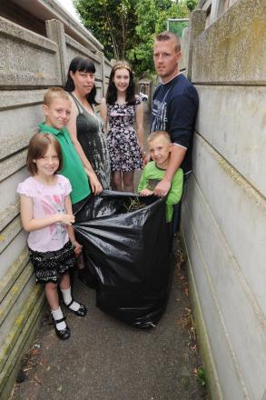 Family's clean-up reopens alleyway