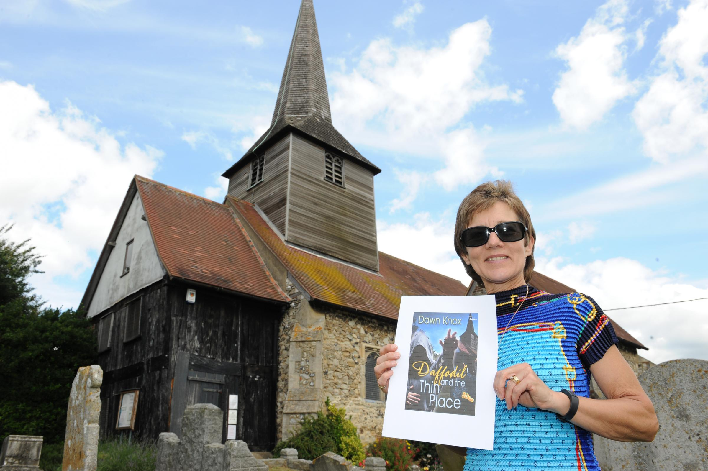 Fundraiser–Dawn Knox with her book cover at the church