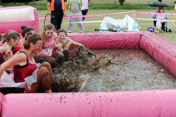Yucky – competitors goes through one of the mud challenges