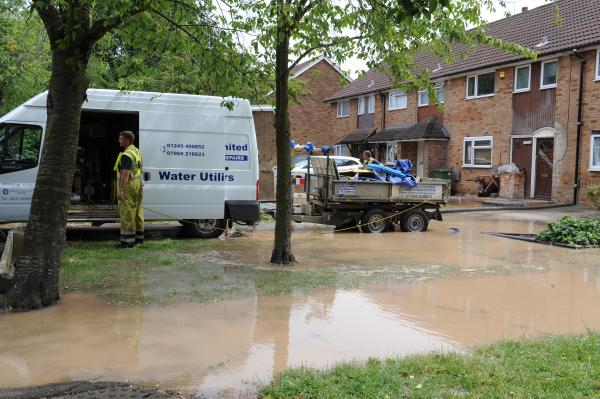 Submerged – workmen outside homes in Tangham Walk