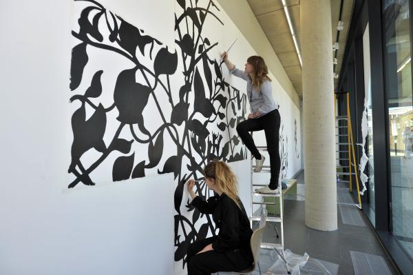 Volunteers at Southend's Focal Point gallery Charlotte Hurst and Ruth Hazel help with a mural designed by David Mabb, head of art at Goldsmiths