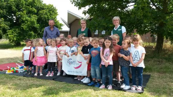 L-R: Peter Hall, Community Fundraiser at Little Havens, Emily Evans, Manager of St Gabriel's Playgroup, June Cartey, Deputy Manager of St Gabriel's Playgroup, with some of the children who took part in the treasure hunt