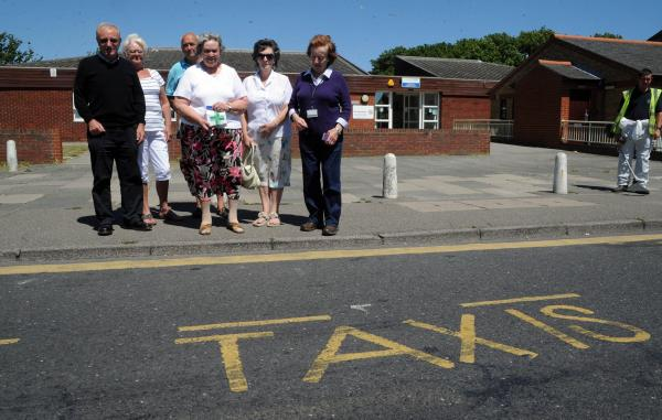 Move it! Councillor Anne Chalk and campaigners by the taxi rank they want shifted