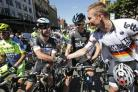 Mark Cavendish, left, talks to Chris Froome prior to the start of the first stage of the Tour de France