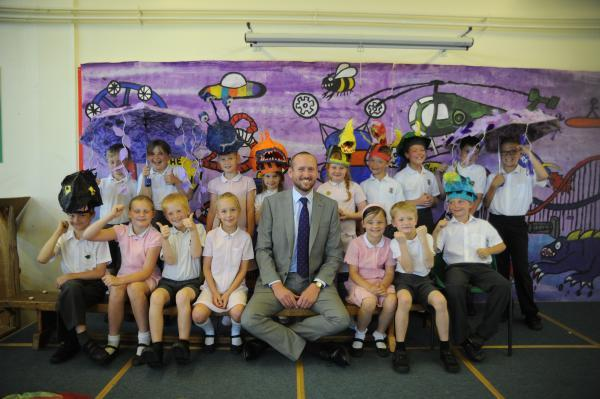Progress - headteacher Jim Johnson with some of his outstandingly well-behave