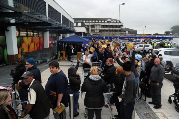 Spend a little, queue a lot! Hundreds of shoppers wait from 2am to bag a bargain at new Aldi store in Pitsea