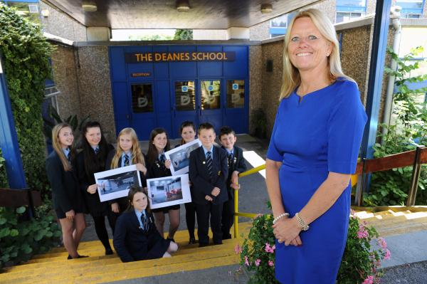 Delighted – headteacher Jan Atkinson with pupils holding artist impressions of the revamp