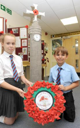 So proud – Scarlett Chamberlin and Dillon Greensmith by the First World War memorial which Scarlett designed and the school made. Dillon brought in his great, great grandfather's medal from the Great War