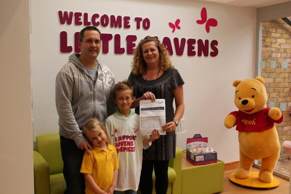 Little fundraiser – Mark, Maisie and Archie Callaway with Havens Hospices' events fundraiser, Jane Hopkins