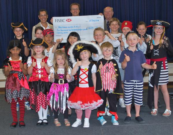 Great effort – charities co-ordinator Lorraine Kipps, headmaster Steve Tompkins, and RNLI Southend chairman James Mackie, surrounded by St Michael's School pirates