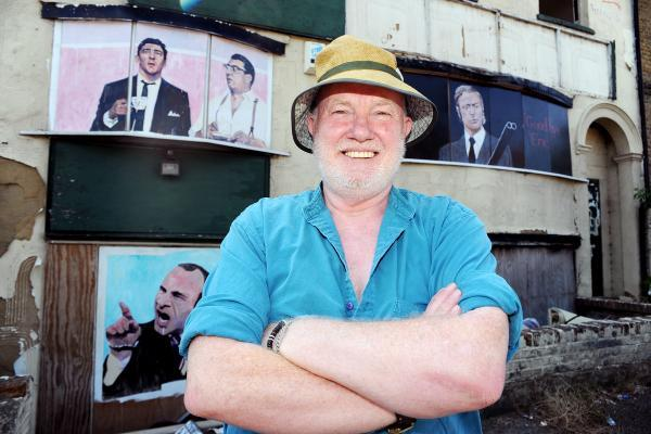 Artistic protest – John Bulley shows off his artwork on the buildings
