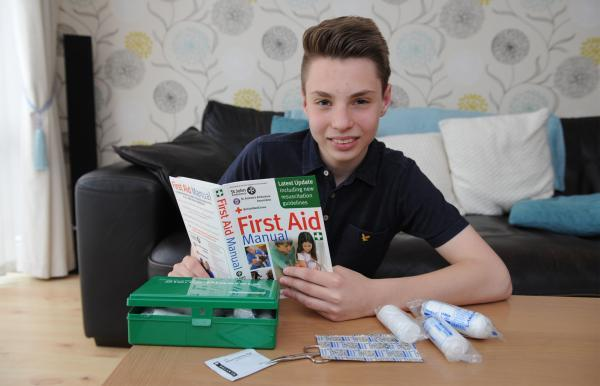 Schoolboy George Sutton brushes up on his first aid