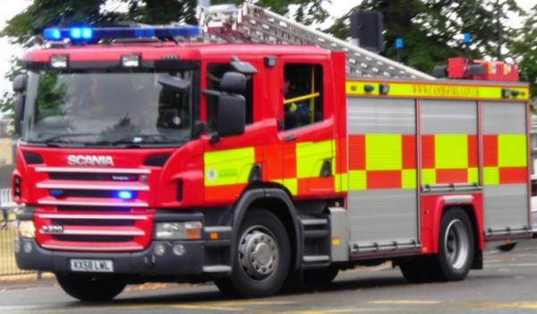 Fire engine hits lamp post