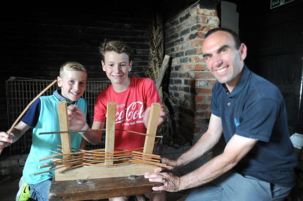 Weaving – Olli and Sam Gaut making a willow wall with education co-ordinator Stephen Andrews