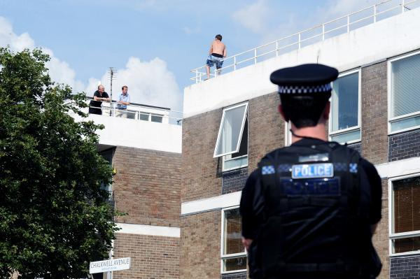 Rooftop 'jumper' blasts police's 'waste of time'