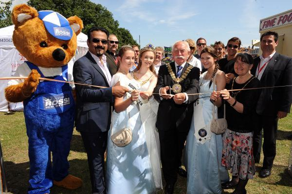 Opening time – Southend mayor Chris Walker cuts the ribbon at Southend Carnival's fair, watched by carnival queen Lauren Green and princesses Bethany Gray and Courtney Cook