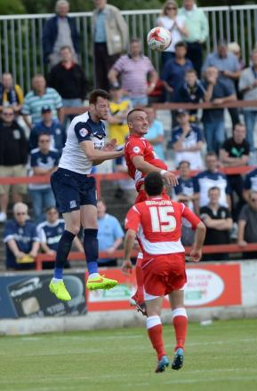 Cian Bolger heads the ball clear on his first game since returning to Southend United