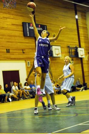 A Swifts player jumps for the hoop