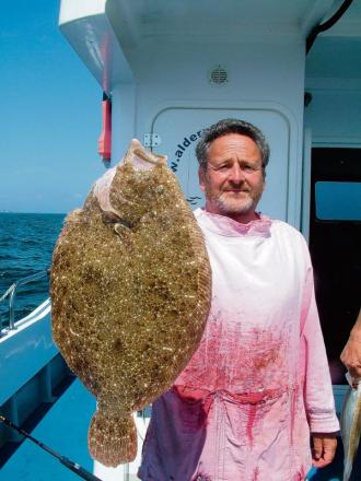 Brill-iant - Mick Toomer with his prized catch
