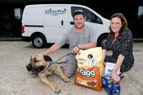 Being put to good use – Roxy the Spanish Mastif, with Acres Way manager Tom Millson and MP Rebecca Harris
