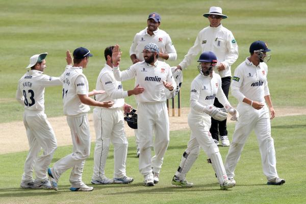 Happy days – Monty Panesar (centre) celebrates taking the wicket of Glamorgan's Will Bragg. Picture: GAVIN ELLIS/TGS PHOTO