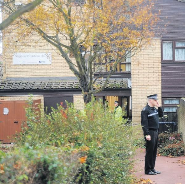 Police guard the scene of the incident, at Stephen McAdden House, in Burr Hill Chase, Southend