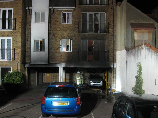 Fire crews inspect the damage following last night's fire under flats in London Road, Westcliff