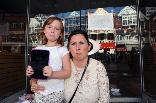 Angry – Dawn Murphy with daughter Lois. Right: The now-empty shop where Mrs Murphy took the tablet for repair.