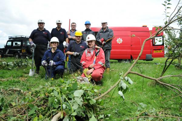 Firefighters muck in to clear ditch