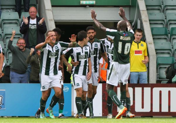 Plymouth Argyle celebrate scoring against the Shrimpers
