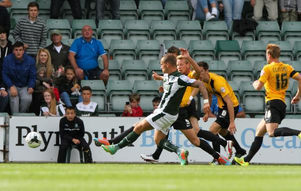 Luke Prosser can only look on as Lewis Alessandra fires Plymouth in front