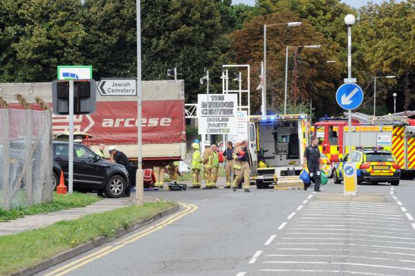 Woman airlifted to hospital after lorry knocks her down