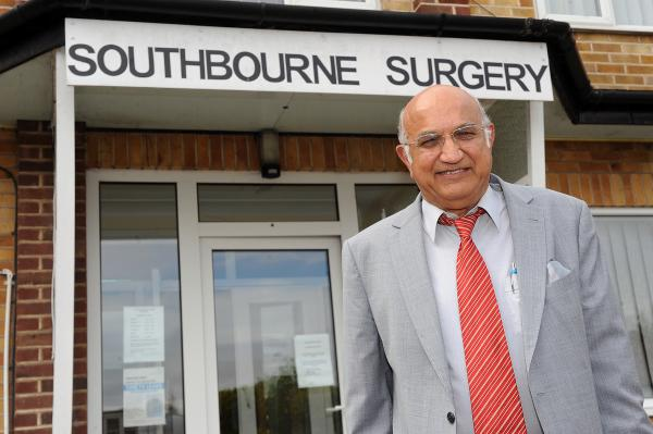 Dr Krishna Chaturvedi outside his Southbourne Grove surgery
