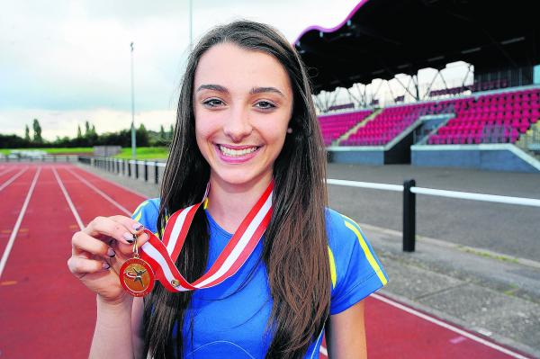 Isobel Ives with her gold medal from the English Championships