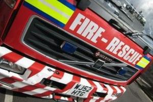 Firefighters rescue three from flat blaze