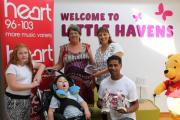 Making a difference – fundraisers Su Harrison and partner Sinclair Walton with Jack Smith, five, who uses Little Havens Children's Hospice, his cousin Elle Foyle, ten, and nan Jenny Smith, all from Southend, who were at the presentation