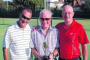 Men's doubles winners – Tim Padbury (left) and Graham Taylor (right) with Southend Lawn president Doug Turrell PIC: AMY BEADLE