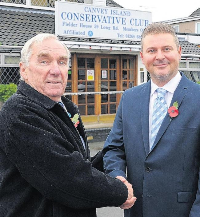 Shake on it – Castle Point Council leader Colin Riley, left, welcomes Mr Cole to the Tory ranks