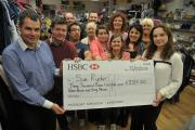 £3,700 windfall - the Sue Ryder charity shop with their cheque