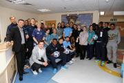 Southend United's players and manager Phil Brown during the visit to Southend Hospital