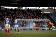 A smoke bomb was let off behind Daniel Bentley's goal at Fratton Park