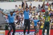 England's Steven Finn, second from left, and teammate Ravi Bopara, left, appeal unsuccessfully for a wicket during today's final