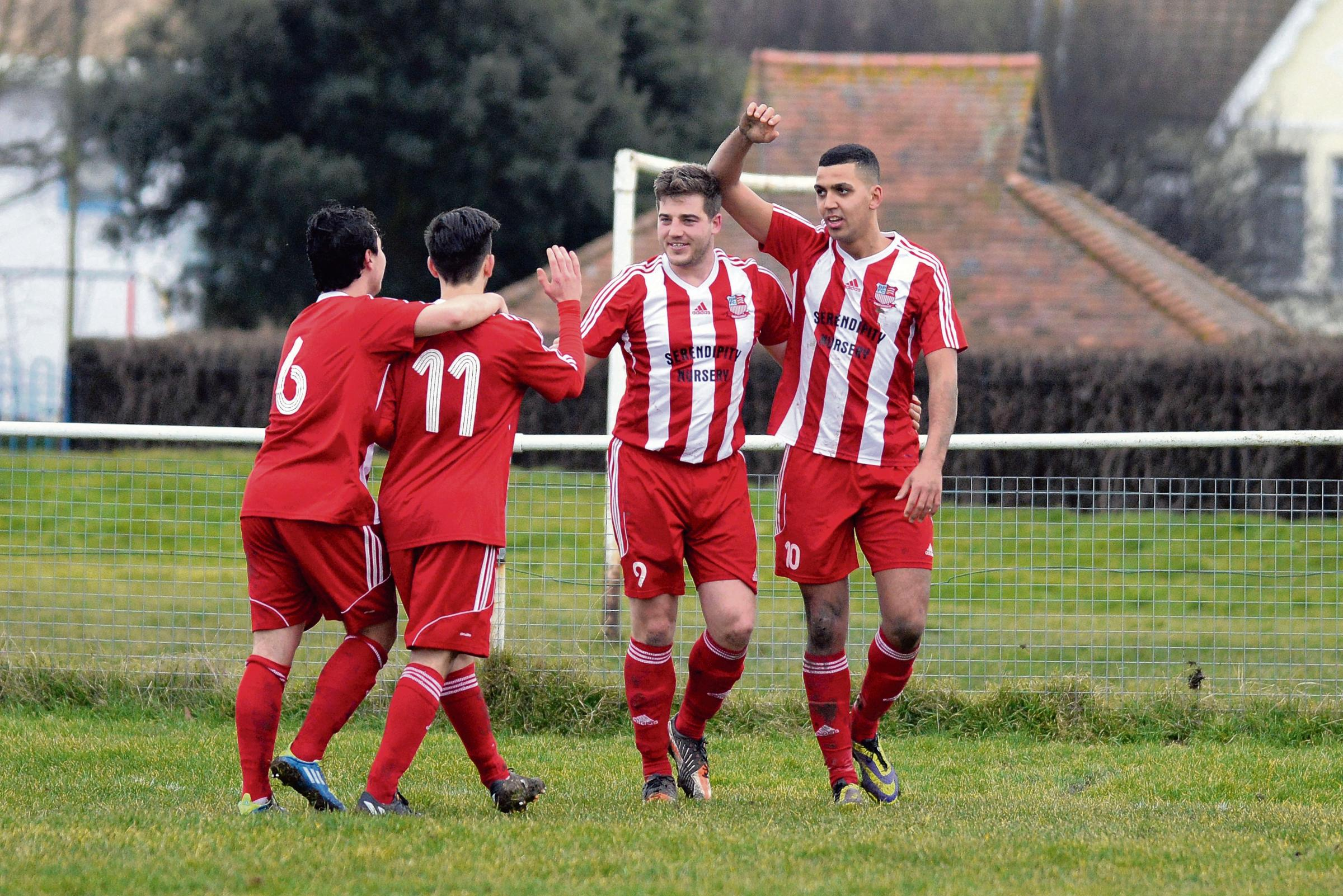 Smiles all around - Whitnell, second right, scored the winner