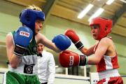 Tough – Billericay ABC's Oliver Wilsher (red hat) takes on Berry's Billy Forbes