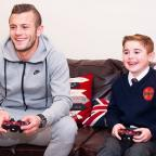 Echo: Jack Wilshere with Archie Hill at the boy's home in Gerrards Cross, Bucks (Muscular Dystrophy Campaign/PA)