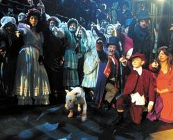 Off! The cast of Oliver! give Bronx his marching orders