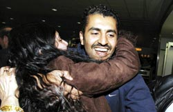 Freed - Maajid Nawaz hugs a supporter after he was released