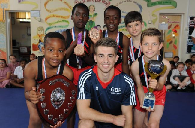 Meeting their idol – Max Whitlock with the St Anne Lyne gymnasts Peter and Phillip Odugbile, Reece Hudson, Adam Hickey, and Uchenna Okereke