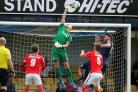 Daniel Bentley claws the ball clear for the Shrimpers